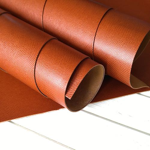 Рыжевато-коричневый кожзаменитель с тиснением Кожа змеи