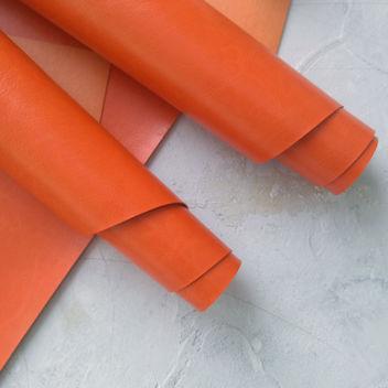 Глянцевый оранжевый переплетный кожзам