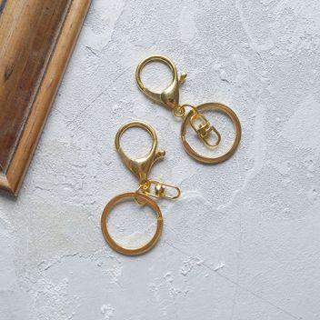 Кольцо с карабином золотое