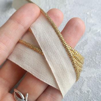 Каптал айвори с золотой кромкой 16мм 1м