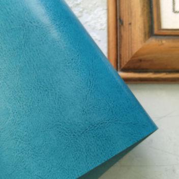 Кожзаменитель глянцевый Глубокого бирюзового цвета под шевро